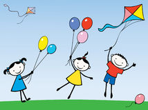 Children with a balls and kite Royalty Free Stock Photography