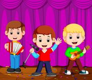 Children in band playing on stage Stock Images