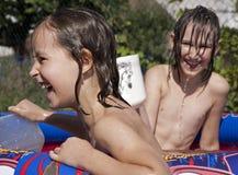Children in basin Stock Image