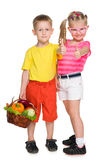 Children with a basket of vegetables Stock Photography