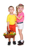 Children with a basket of vegetables Stock Images