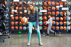 Children with basketballs in sport shop Royalty Free Stock Image