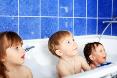 Children in a bath Stock Images