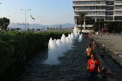Children bathe in a fountain in the central square of Izmir Stock Images
