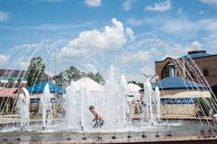 Children bathe in the fountain Royalty Free Stock Image