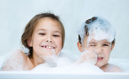 Children bathes in a bathroom Stock Photos