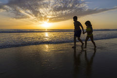 Children bathing on the beach at dusk Royalty Free Stock Photos