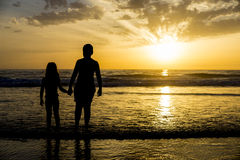 Children bathing on the beach at dusk Stock Photography