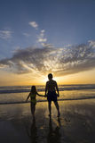 Children bathing on the beach at dusk Stock Photo