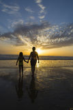 Children bathing on the beach at dusk Stock Image