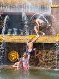 Children bathing near a fountain Stock Images