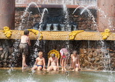 Children bathing near a fountain Royalty Free Stock Image