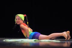 Children in bathing suits  dancing on stage Stock Photography