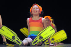 Children in bathing suits  dancing on stage Royalty Free Stock Photo