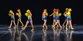 Children in bathing suits  dancing on stage Stock Photos