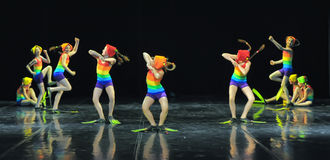 Children in bathing suits  dancing on stage Stock Photo