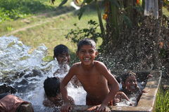 Children bathing in tube-well Royalty Free Stock Images