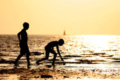 Children in the beach. At dusk Stock Photo