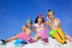 Children on Beach. Three siblings on the beach wearing colorful diving gear Stock Photography