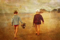 Children on the beach. Children walking on the beach Royalty Free Stock Photo