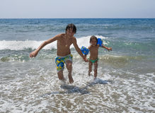 Children on the beach Stock Images