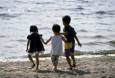 Children at the Beach. Young Chinese children at the beach. Ottawa, Ontario Stock Images