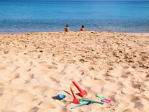 Children on a beach. With sand toys royalty free stock photo