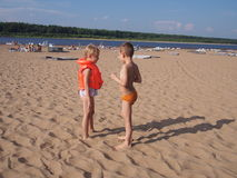 Children at the beach. Boy and girl talk at the beach Royalty Free Stock Photos