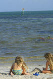 Children at the beach with divers. In the background stock photos