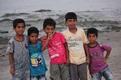 Children on a beach in Oman Stock Photography