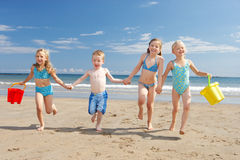 Children on beach vacation. Running towards camera stock photos