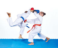 Children are beating karate punches on the mat Royalty Free Stock Photo