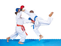 Children are beating karate punches on the mat isolated Royalty Free Stock Image