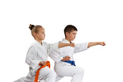 Children are beating punch hand in rack of karate Royalty Free Stock Photography
