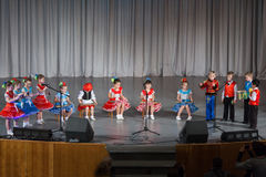 Children in beautiful costume performs on stage Royalty Free Stock Image