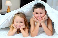 Children in bed Royalty Free Stock Photos