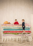 Children on the bed - Princess and the Pea. Stock Image