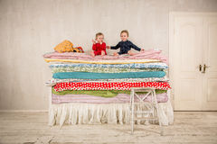Children on the bed - Princess and the Pea. Royalty Free Stock Images