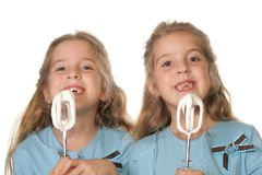 Children begging to lick beaters royalty free stock images