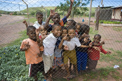 Children behind a fence in Namibia Royalty Free Stock Photos