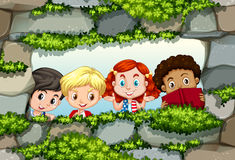 Children behind the stone wall Stock Photos
