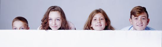 Children behind white empty banner.  royalty free stock images