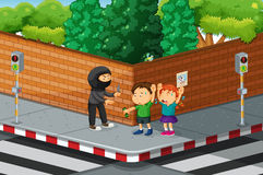 Children being robbed at the street corner Royalty Free Stock Photography