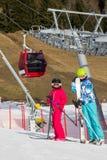 Children below ski lift in Stock Photography