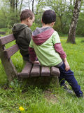 Children on bench in park Royalty Free Stock Photography