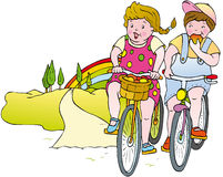 Children bicycle. Children cycling along a country road Royalty Free Stock Images
