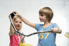 Children with bicycle Royalty Free Stock Photography