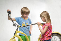 Children with bicycle Royalty Free Stock Images
