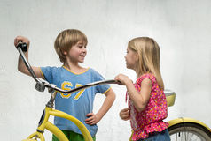 Children with bicycle Stock Photography