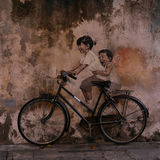 Children on a Bicycle, Georgetown, Penang, Malaysia in 2016 stock photo